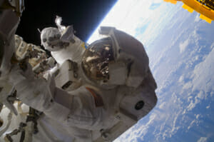 Astronaut hovering over Earth