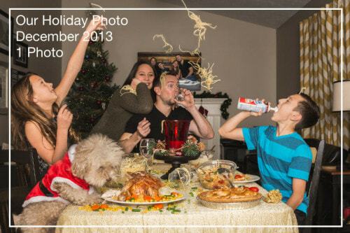 Family goofing off during a holiday feast